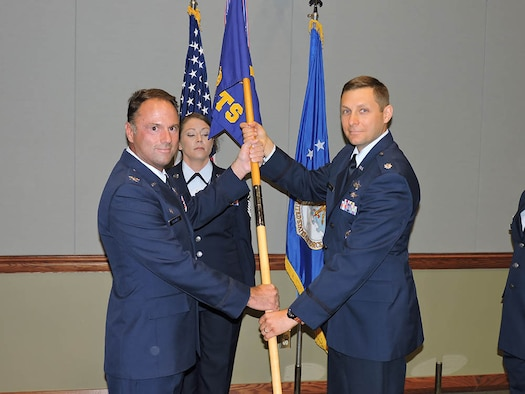 (Right) Lt. Col. Adam Fisher, 14th Test Squadron Commander, receives the guidon from Col. Dean Caldwell, 926th Operations Group Commander, during a change of command ceremony July 8 at the Air Force Warfare Center. (U.S. Air Force photo/Senior Airman Victoria Carr)