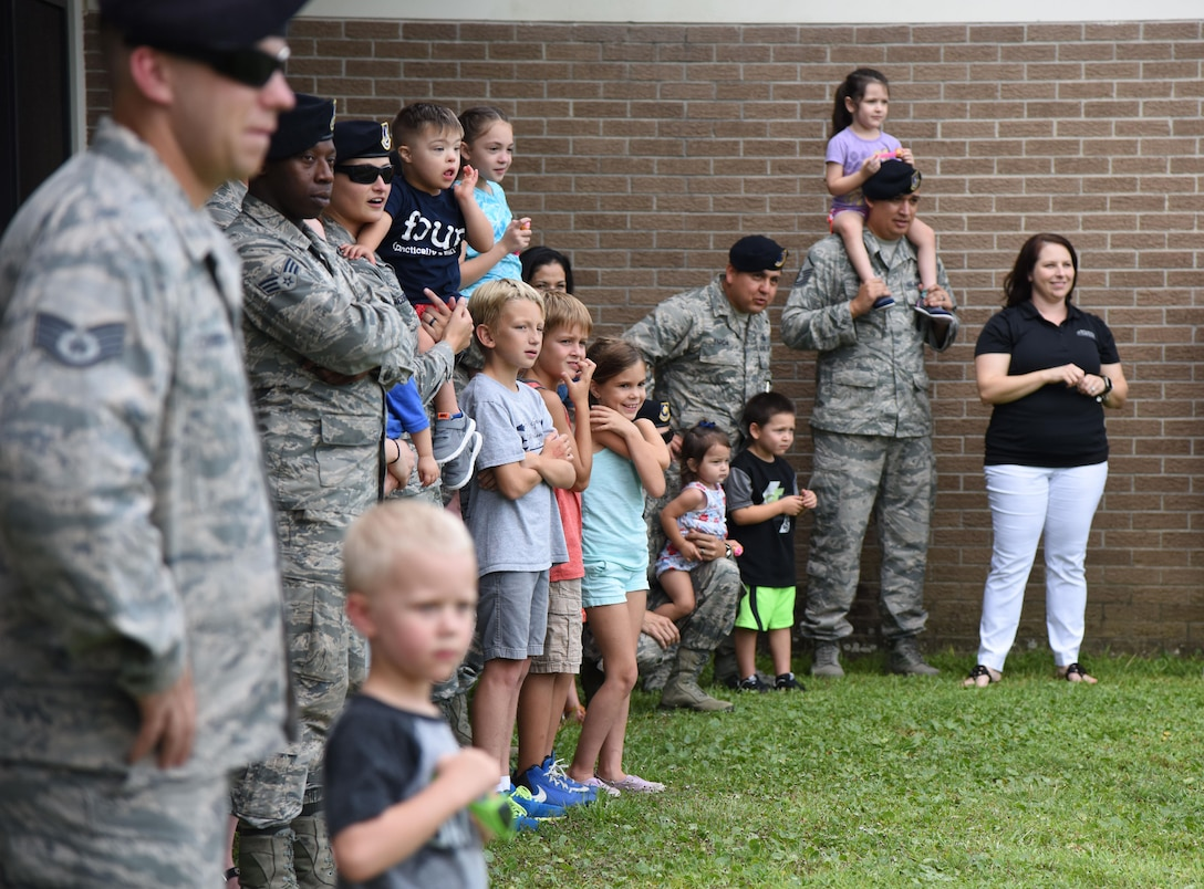 Member of the 81st Security Forces Squadron and their families attend a military working dog demonstration during a family ice cream social at the 81st SFS building July 27, 2017, on Keesler Air Force Base, Miss. The event, hosted by the 81st SFS Defenders Council and Key Spouses, also consisted of a combat arms weapons display and ice cream. (U.S. Air Force photo by Kemberly Groue)