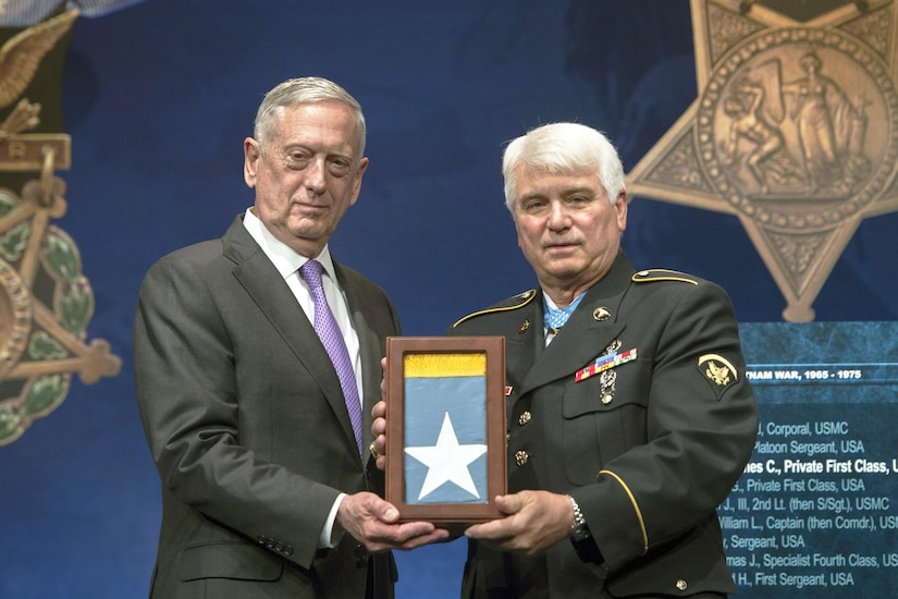 Defense Secretary Jim Mattis presents the Medal of Honor flag to Army Spc. 5 James C. McCloughan during McCloughan's induction into the Pentagon's Hall of Heroes, Aug. 1, 2017. McCloughan was awarded the Medal of Honor yesterday by President Donald J. Trump for distinguished actions as a combat medic during the Vietnam War. DoD photo by Air Force Tech. Sgt. Brigitte N. Brantley