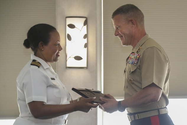 "Lt. Gen. Lewis Craparotta, Commanding General, I Marine Expeditionary Force, receives a token of appreciation for his hard work from U.S. Navy Cmdr. Denise McCallaCreary, President of the National Naval Officers Association Symposium (NNOA), at the Admiral Kidd Catering & Conference Center, Naval Base Point Loma, Calif., July 26, 2017. The NNOA actively supports U.S. Marine Corps, Navy, Coast Guard and the National Oceanic and Atmospheric Administration in the recruitment, development and retention of a diverse Officer Corps that is representative of the best our nation has to offer. The theme of this year's symposium was ""Developing Leaders Through Education, Experience and Personal Development."" (U.S. Marine Corps photo by Pfc. Noah M. Rudash)"