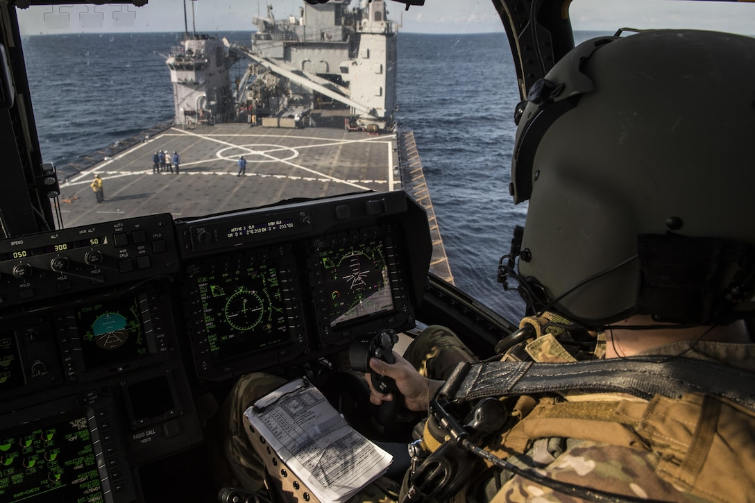 A pilot with the 8th Special Operations Squadron maneuvers a CV-22 Osprey tiltrotor aircraft onto the amphibious dock landing ship USS Oak Hill (LSD 51) during a deck landing qualification flight off the coast of Virginia, July 25, 2017. The 8th SOS conducts deck landings four to six times a year to ensure aircrews are qualified, current and ready to conduct global operations any time, any place. (U.S. Air Force photo by Airman 1st Class Joseph Pick)