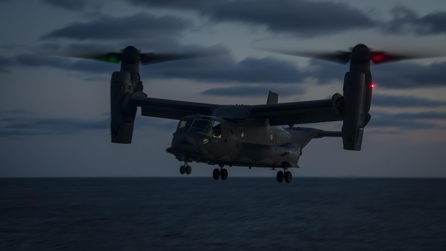 A CV-22 Osprey tiltrotor aircraft with the 8th Special Operations Squadron approaches the amphibious dock landing ship USS Oak Hill (LSD 51) during deck landing qualifications off the coast of Virginia, July 26, 2017. The 8th SOS conducts deck landings four to six times a year to ensure aircrews are qualified, current and ready to conduct global operations any time, any place. (U.S. Air Force photo by Airman 1st Class Joseph Pick)