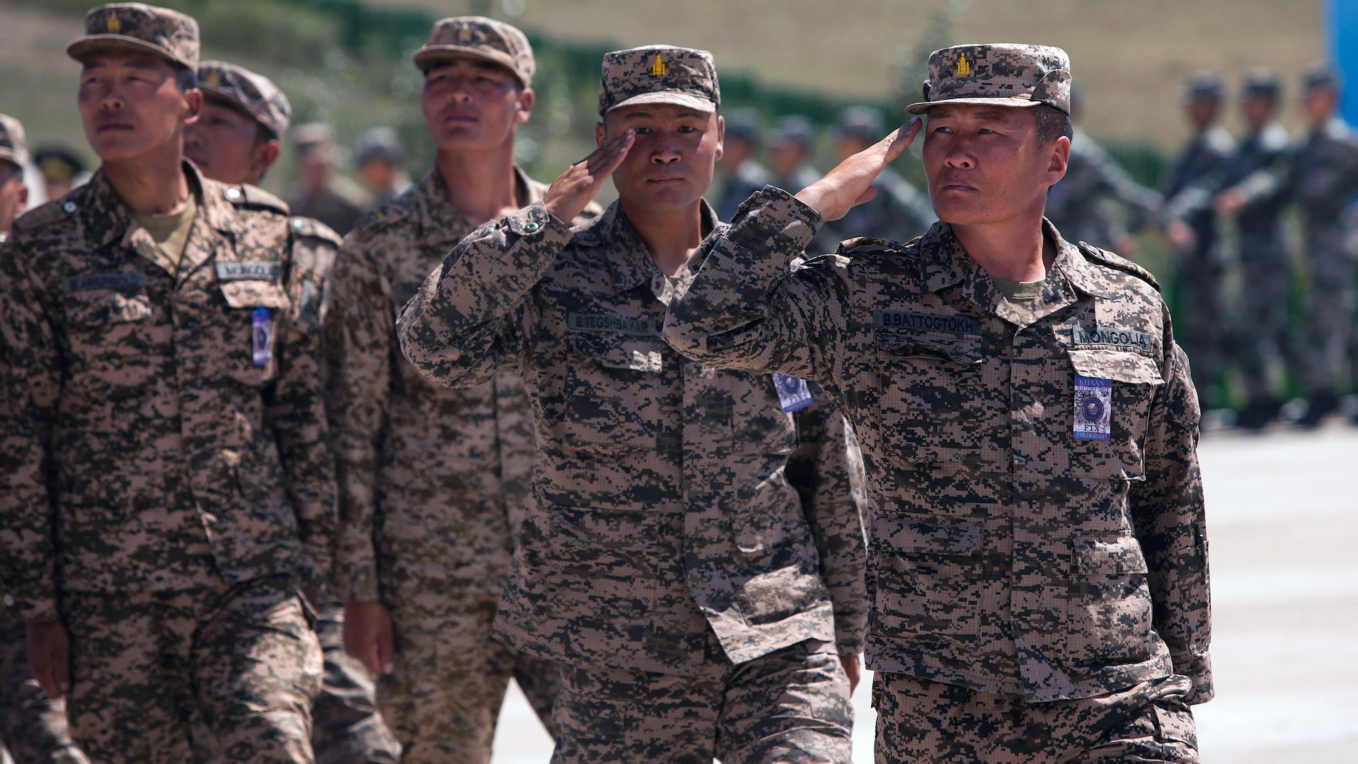 Mongolian Armed Forces service members conduct the pass and review during the opening ceremony of Exercise Khaan Quest 2017 at Five Hills Training Area, Mongolia, July 23, 2017. Khaan Quest 2017 is a Mongolian-hosted, combined, joint training exercise designed to strengthen the capabilities of the U.S., Mongolia and other partner nations in international peacekeeping operations.