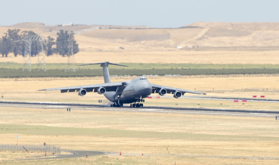 A C-5A Galaxy lands at Travis Air Force Base, Calif., July 26, 2017. The C-5, Tail No. 0451, spent nearly 20 years operating at Travis from 1973 to 1992 and is the Air Force's second-to-last operational C-5A. The aircraft is slated to be placed on static display at the Travis Heritage Center. (U.S. Air Force photo/ Heide Couch)