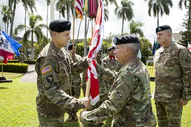 Col. Thomas J. Tickner (left) receives the Army Colors from Lt. Gen. Todd T. Semonite, Chief of Engineers and Commanding General of the U.S. Army Corps of Engineers in a Change-of-Command ceremony, July 27, at Fort Shafter, Hawaii.   Brig. Gen. Peter B. Andrysiak (right) relinquished command of the USACE-POD to Tickner, who became the 33rd commander of the division. Photo by Duy Ta, USACE-ACE-IT