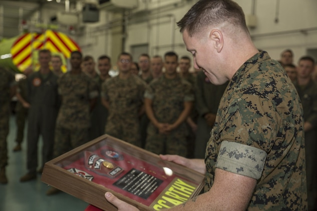 U.S. Marine Corps Chief Warrant Officer 4 Derek McCarthy, the officer in charge of Aircraft Rescue and Firefighting (ARFF) with Headquarters and Headquarters Squadron (H&HS), accepts a memorial box at Marine Corps Air Station Iwakuni, Japan, Aug. 1, 2017. Marines presented McCarthy with the box after celebrating their accomplishments as the 2016 ARFF Unit of the Year and the 2016 United States Marine Corps Small Fire Department of the Year. (U.S. Marine Corps photo by Lance Cpl. Gabriela Garcia-Herrera)