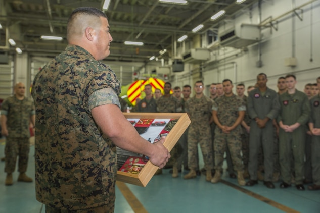 U.S. Marine Corps Master Sgt. Marcos Martinez, staff noncommissioned officer in charge of Aircraft Rescue and Firefighting (ARFF) with Headquarters and Headquarters Squadron (H&HS), accepts a memorial box at Marine Corps Air Station Iwakuni, Japan, Aug. 1, 2017. ARFF celebrated their accomplishment as the 2016 ARFF Unit of the Year and the 2016 United States Marine Corps Small Fire Department of the Year. Marines thanked Martinez with mementos from Iwakuni to remind him of his time served at the station as he prepares to depart from the installation. (U.S. Marine Corps photo by Lance Cpl. Gabriela Garcia-Herrera)