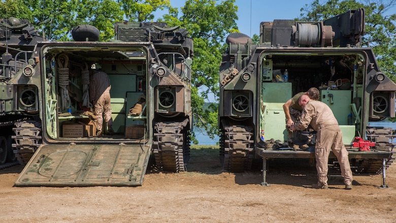 U.S. Marines with Bravo Company, 4th Amphibious Assault Battalion, 4th Marine Division, Marine Forces Reserve, work on Amphibious Assault Vehicles at Camp Grayling, Michigan, during exercise Northern Strike 2017, July 31, 2017. Northern Strike 2017 brought together Reserve Marine from across the country to provide realistic combined arms trainings to cover a spectrum of combat scenarios.
