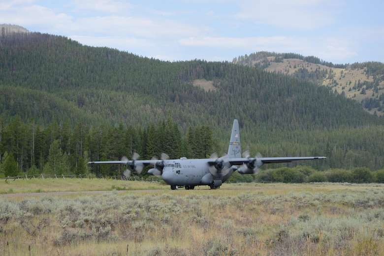 A C-130 Hercules aircraft from the 120th Airlift Wing, Montana Air National Guard backs up to the end of the air strip before taking off July 27, 2017, at the Benchmark Airport near Augusta, Mont.