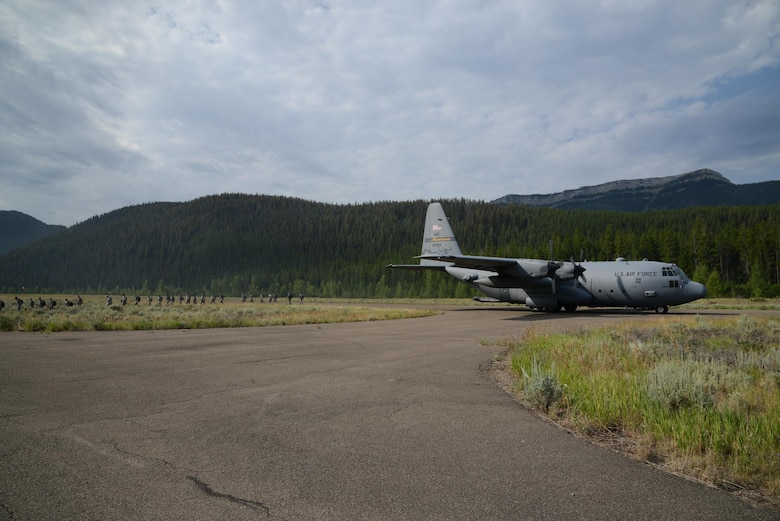 Airmen from the 819th RED HORSE Squadron depart a C-130 Hercules aircraft from the 120th Airlift Wing, Montana Air National Guard, July 27, 2017, at the Benchmark Airport near Augusta, Mont.