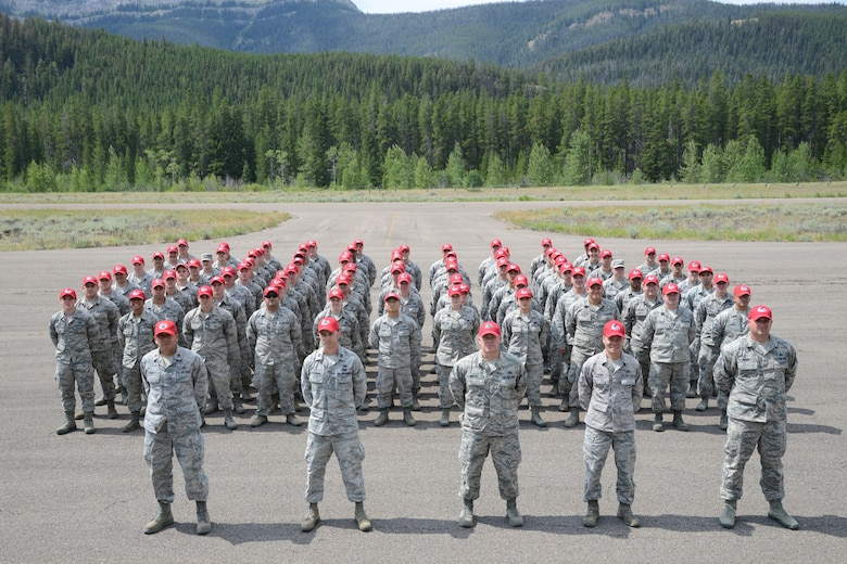 Airmen from the 819th RED HORSE Squadron pose for a group photo during an exercise July 27, 2017, at the Benchmark Airport near Augusta, Mont.