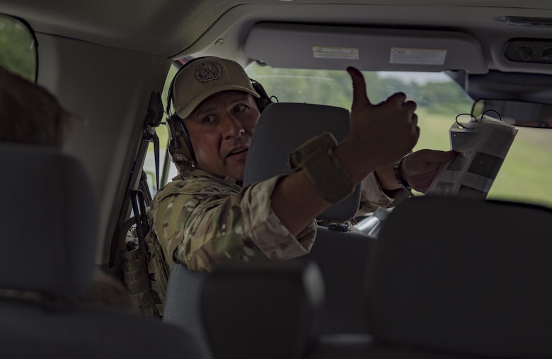 Master Sgt. Francisco Corona, 93d Air Ground Operations Wing NCO in charge of weapons and tactics, communicates with a fellow joint Terminal Attack Controller during a close air support training exercise, July 26, 2017, in Lakeland, Ga. Two RAF members recently spent time immersing with the 93d Air Ground Operations Wing to compare and contrast how each entity conducts business and plan future coalition training events. (U.S. Air Force photo by Airman 1st Class Daniel Snider)