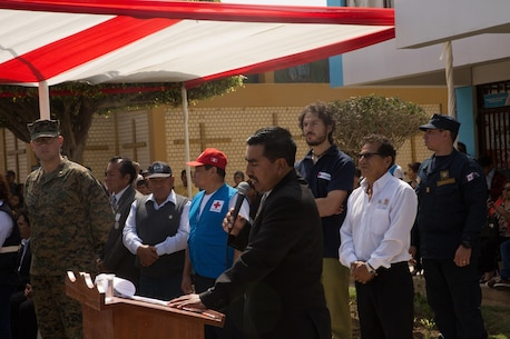 Miguel Sotelo, the mayor of Huarmey, Peru, delivers a speech during a welcoming ceremony for U.S. and Peruvian service members during a community relations event in Huarmey as part of UNITAS 2017, July 24, 2017. Much of Huarmey had been damaged by recent flooding, and Marines delivered more than 100 pallets of donated items from Project Handclasp for the city's hospital and schools. Project Handclasp is a U.S. Navy program that delivers humanitarian and educational materials donated by U.S. citizens. UNITAS is an annual, multinational exercise that focuses on strengthening existing regional partnerships and encourages establishing new relationships through the exchange of maritime mission-focused knowledge and expertise during multinational training operations. (U.S. Marine Corps photo by 1st Lt. Marco Valenzuela)
