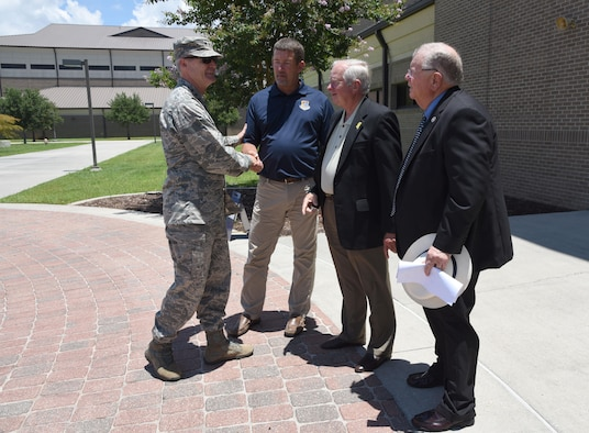 Lt. Gen. Darryl Roberson, commander of Air Education and Training Command, says good-bye to John Boothby, Frank Genzer and Lenny Sawyer, Keesler honorary commanders, after a tour at Matero Hall July 19, 2017, at Keesler Air Force Base, Miss. (U.S. Air Force photo by Kemberly Groue)