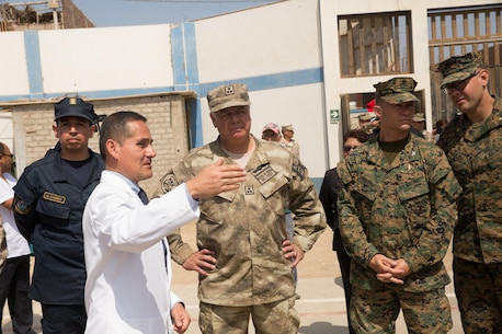 U.S. and Peruvian military leaders listen to Dr. Cesar Saavedra, the director of Hospital Apoyo Huarmey, during a community relations event in Huarmey, Peru as part of UNITAS 2017, July 24, 2017. Much of Huarmey had been damaged by recent flooding, and Marines delivered more than 100 pallets of donated items from Project Handclasp for the city's hospital and schools. Project Handclasp is a U.S. Navy program that delivers humanitarian and educational materials donated by U.S. citizens. UNITAS is an annual, multi-national exercise that focuses on strengthening existing regional partnerships and encourages establishing new relationships through the exchange of maritime mission-focused knowledge and expertise during multinational training operations. (U.S. Marine Corps photo by 1st Lt. Marco Valenzuela)