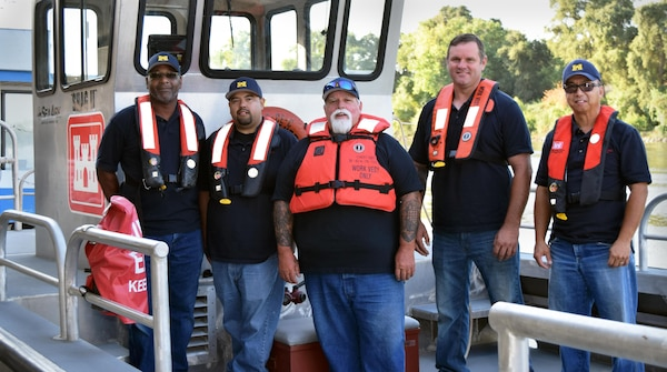 It is hard to corral the entire Bryte Yard team for a group photo. From left to right are: Tony Theard, Vince Diaz, Mike Guidry, Aaron Brandenburg and Ken Kuo. James Helm was away on Coast Guard Reserve duty when the photo was taken.