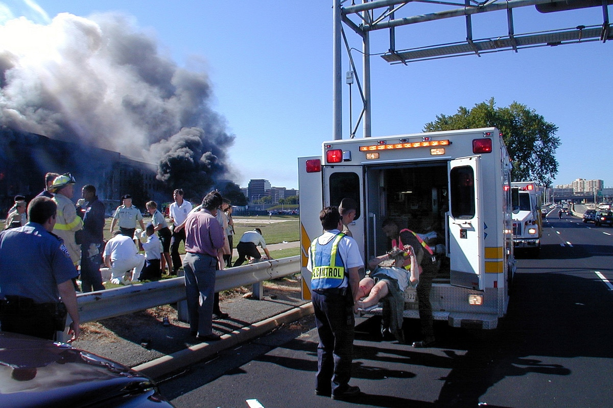 Medical personnel load the injured onto an ambulance near the Pentagon.