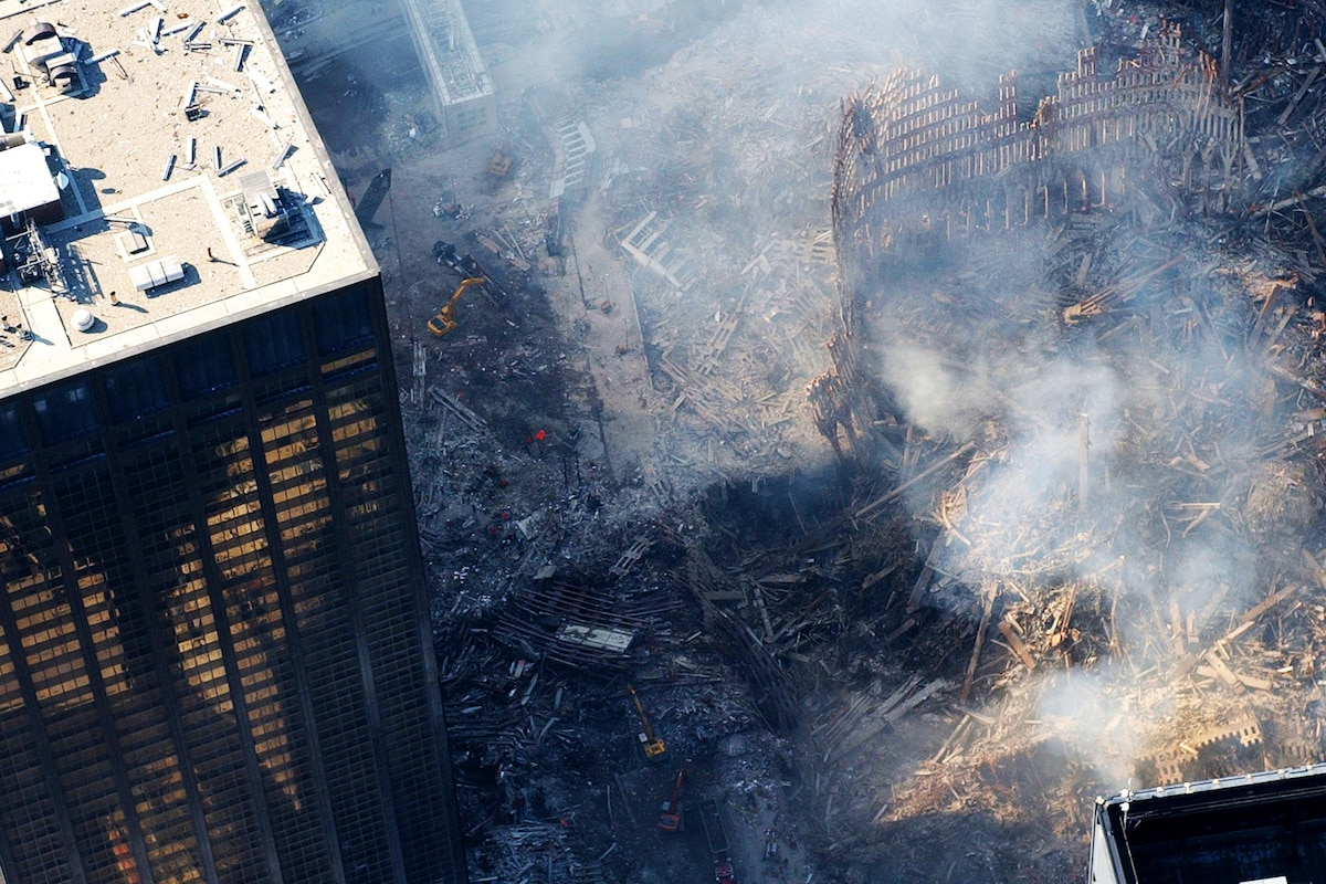 Smoke continues to waft from ground zero days after the attack.