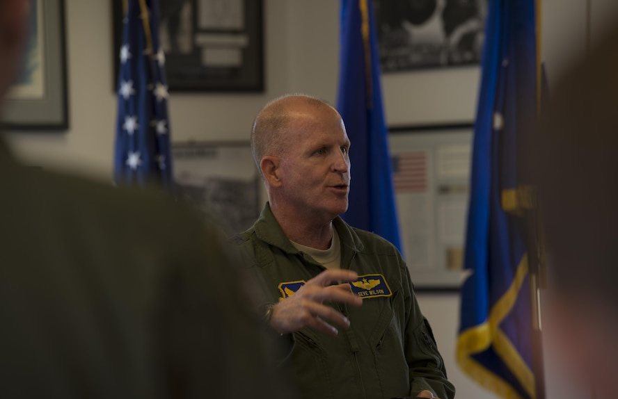 Air Force Vice Chief of Staff Gen.Stephen W. Wilson addresses members of the 390th Electronic Combat Squadron at Whidbey Island Naval Air Station, Wash., July 25, 2017. Wilson was invited to be the key note speaker for an electronic warfare symposium. (U.S. Air Force photo by Senior Airman Jessica H. Smith/Released)