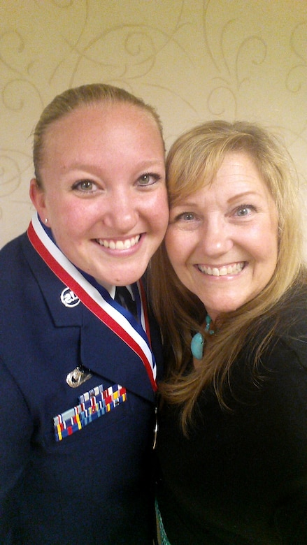 (From left) U.S. Air Force Staff Sgt. Brittany E.N. Murphy, 633rd Air Base Wing photojournalist, and her mom Mary Dudley pose for a photo during an Airman Leadership School graduation at Joint Base Langley-Eustis, Va., May 12, 2016
