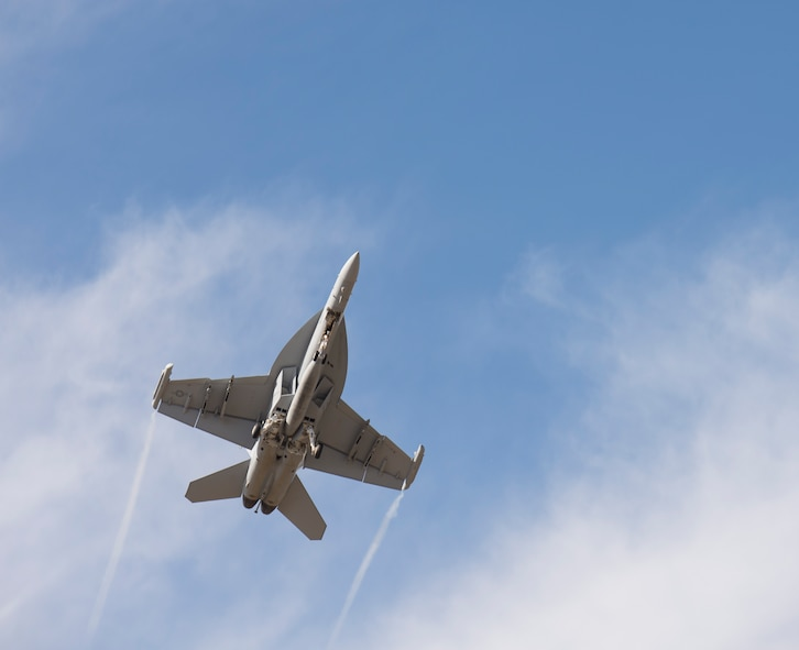 An EA-18G takes off from Whidbey Island Naval Air Station, Wash., July 26, 2017. The 390th Electronic Combat Squadron works hand in hand with the Navy in electronic warfare. (U.S. Air Force photo by Senior Airman Jessica H. Smith/Released)