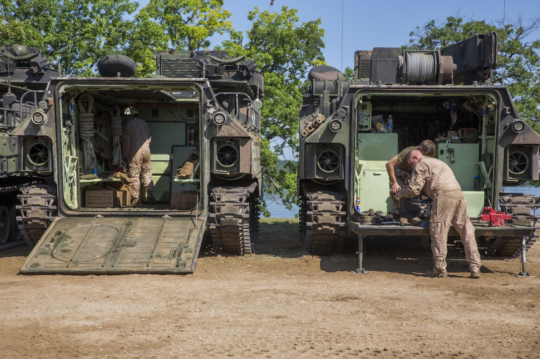 U.S. Marines from Echo Company, 4th Reconnaissance Battalion, 4th Marine Division, Marines Forces Reserve, pull their combat rubber raiding craft from Lake Margrethe, at Camp Grayling Joint Maneuver Training Center, Michigan, during exercise Northern Strike 2017, July 31, 2017.