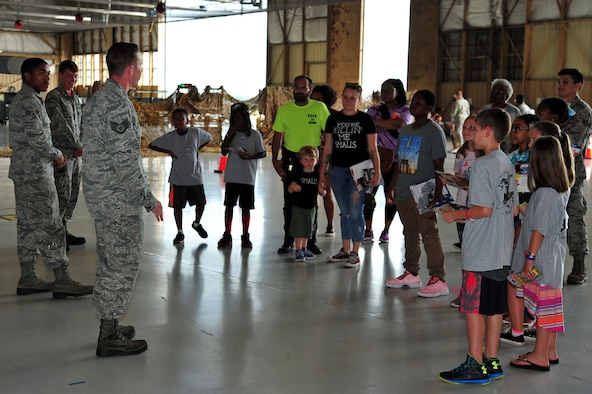 U.S. Airmen assigned to the 20th Aircraft Maintenance Squadron speak to Team Shaw members and their families about the capabilities of an F-16CM Fighting Falcon during a Kids Meet the Shaw Weasels event, hosted by the 20th Force Support Squadron Airman and Family Readiness Center, at Shaw Air Force, S.C., July 28, 2017. The children were told about how Airmen from across the installation work together to ensure the 20th Fighter Wing's F-16s are mission-ready. (U.S. Air Force photo by Airman 1st Class Kathryn R.C. Reaves)