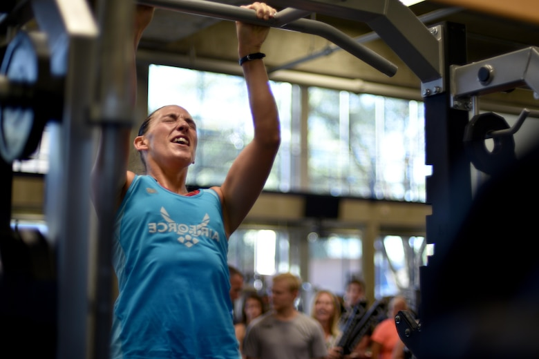 U.S. Air Force Master Sgt. Jennifer Negley, 316th Training Squadron Flight Chief, performs a pull-up during San Angelo Special Ops Challenge in the Ben Kelly Center for Human Performance in San Angelo, Texas, July 29, 2017. Participants must complete at least six pull-ups in under two minutes to qualify for special operations. (U.S. Air Force photo by Airman 1st Class Randall Moose/Released)