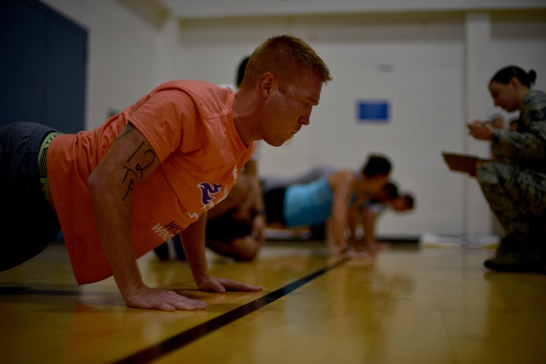 U.S. Air Force Tech Sgt. Derek Gammel, 312th Training Squadron flight chief, performs push-ups during San Angelo Special Ops Challenge in the Ben Kelly Center for Human Performance in San Angelo, Texas, July 29, 2017. Participants must complete at least 35 push-ups in under two minutes to qualify for special operations. (U.S. Air Force photo by Airman 1st Class Randall Moose /Released)