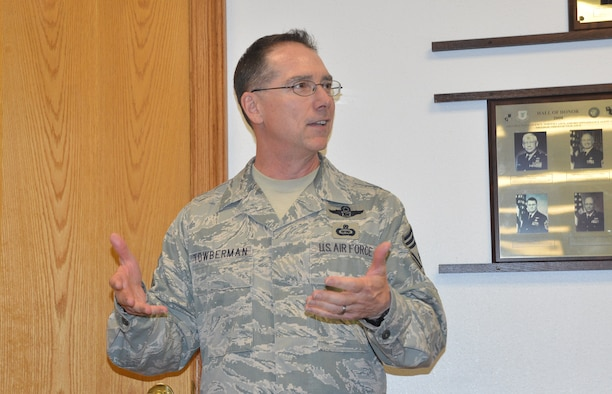 Chief Master Sgt. Roger Towberman, former command chief, 25th Air Force, speaks to Airmen July 27 as he prepares to depart for his new assignment at the Pentagon.