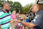 Police sergeant hands DLA police badge to young girl