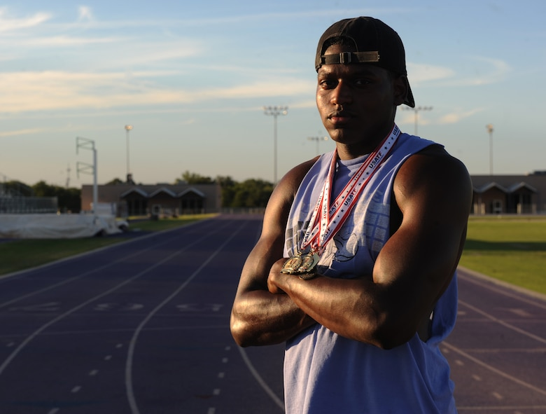 U.S. Air Force Senior Airman Parnelle Shands, 317th Aircraft Maintenance Squadron crew chief, wears medals won from previous track and field events at Abilene Christian University, Texas, July 14, 2017. Shands participated in several events with the U.S. Air Force Track and Field team such as long jump, 100-meter dash and a 4x100 relay. (U.S. Air Force photo by Airman Kylee Thomas)