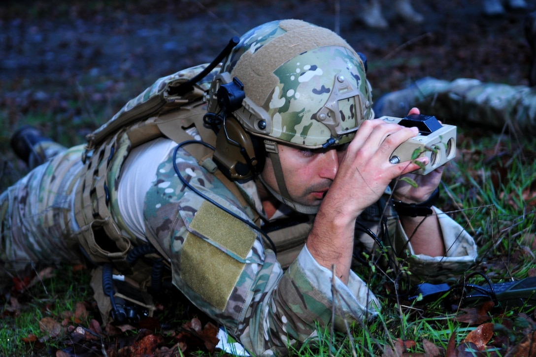 A tactical air control party specialist from the 116th Air Support Operations Squadron assesses the exercise battlefield during Exercise Cascade Warrior on Nov. 8 at Joint Base Lewis-McChord.