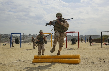 A recruit from India Company, 3rd Recruit Training Battalion, jumps over an obstacle during Bayonet Assault Course I at Marine Corps Recruit Depot San Diego, Aug. 2. Recruits learn to move quickly during the course to get cover behind the different obstacles. Annually, more than 17,000 males recruited from the Western Recruiting Region are trained at MCRD San Diego. India Company is scheduled to graduate Oct. 13.