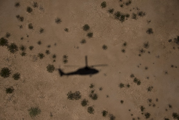 An Army UH-60 Black Hawk casts a shadow on the desert floor during a fly-away training mission as part of Operation Enduring Training in Florence, Ariz., July 21, 2017. The Explosive Ordnance Disposal unit assigned to the 56th Civil Engineer Squadron at Luke Air Force Base participated in a day-long training mission which included medevac and dismounted improvised explosive device scenarios. (U.S. Air Force photo/Airman 1st Class Alexander Cook)