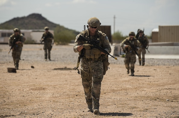 Senior Airman Devon Vorse, 56th CES EOD team member, leads the rest of his team to the next training scenario during a fly-away training mission July, 21, 2017, at the Florence Military Training Reservation in Florence, Ariz. Throughout the day, teams used communication and teamwork to tackle rigorous contingency scenarios. (U.S. Air Force Photo/ Airman 1st Class Alexander Cook)