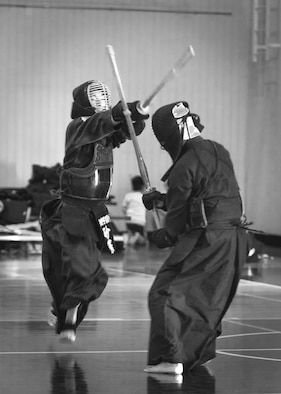A kendo practitioner strikes his opponent's head during the Kendo Club Joint Summer Camp at Yokota Air Base, Japan, July 29, 2017. Yokota Kendo Club has practiced every Saturday for about 25 years. Kazuto Miura, headmaster of Keitenkan Dojo in Akishima city, founded Yokota Kendo Club and started to teach kendo on base. Yokota Kendo Club and Keitenkan Dojo hold summer camps together annually; this is the sixth time the summer camp has been held on base. (U.S. Air Force photo by Machiko Arita)