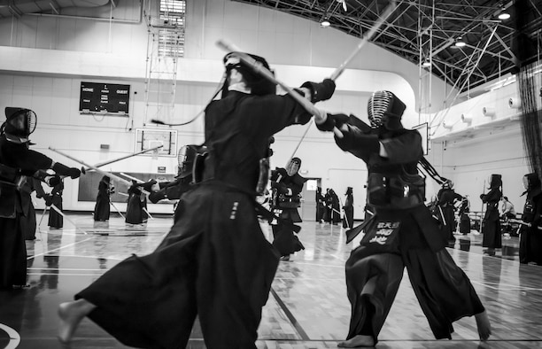 Kendo practitioners spar during the Kendo Club Joint Summer Camp at Yokota Air Base, Japan, July 29, 2017. Approximately 60 practitioners participated in the joint summer camp this year. After practice, they held a BBQ to deepen the friendship. (U.S. Air Force photo by Machiko Arita)