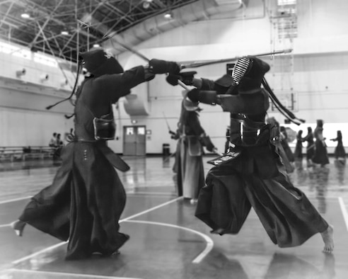 A kendo practitioner strikes his opponent's head during the Kendo Club Joint Summer Camp at Yokota Air Base, Japan, July 29, 2017. Yokota Kendo Club has practiced every Saturday for about 25 years. Members consist of U.S. Air Force active-duty service members, civilian employees, their dependents, local nationals and Japan Air Self-Defense Forces members. (U.S. Air Force photo by Machiko Arita)