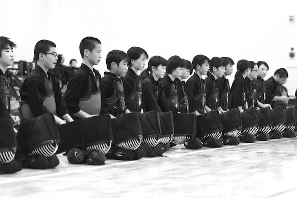 Students sit in seiza (kneeling position) at the end of the class during the Kendo Club Joint Summer Camp at Yokota Air Base, Japan, July 29, 2017. Students line up and sit in seiza for meditation and bowing at the beginning and end of each session. Kendo teaches the importance of proper manners and etiquette. (U.S. Air Force photo by Machiko Arita)