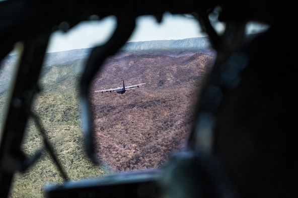 A U.S. Air Force 17th Special Operations Squadron MC-130J Commando II flies in dissimilar formation with a No. 37 Squadron Royal Australian Air Force C-130J Hercules July 19, 2017, over Queensland, Australia. Talisman Saber 2017 provided the opportunity at further developing interoperability with counterparts from the RAAF through daily airborne operations to include low-level formation work, forward air refueling point, and personnel and cargo airdrops. (U.S. Air Force photo by Capt. Jessica Tait)