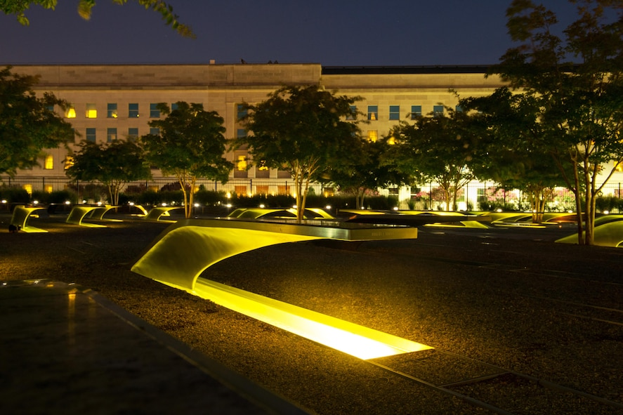Lights illuminate memorial benches at the National 9/11 Pentagon Memorial.
