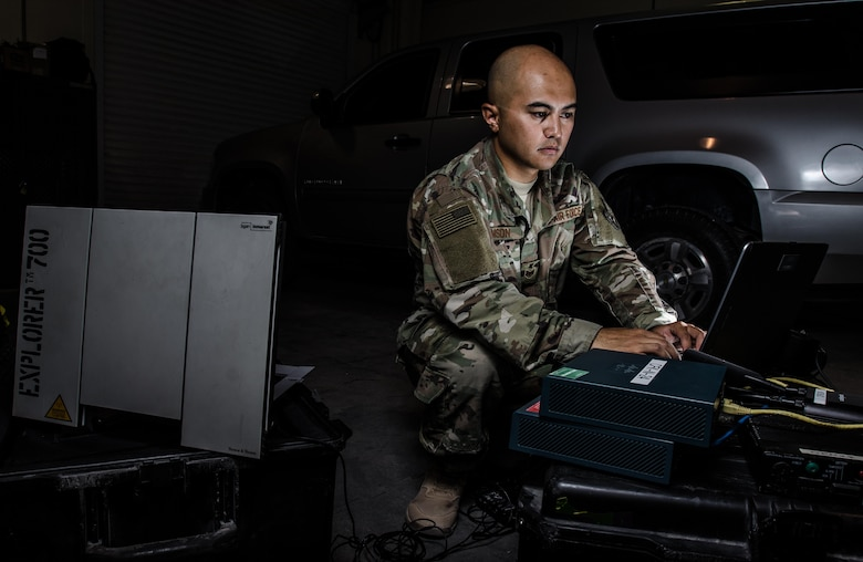 U.S. Air Force Staff Sgt. Junbryan Samson, a cyber network technician assigned to the U.S. Air Forces Central Command communications division at the Combined Air Operations Center, tests a communications fly-away kit July 31, 2017, at Al Udeid Air Base, Qatar. Samson ensures the CFK is maintained and ready to deploy at a moments notice to bases around the AFCENT region to create command and control network connections. (U.S. Air Force photo by Staff Sgt. Alexander W. Riedel)