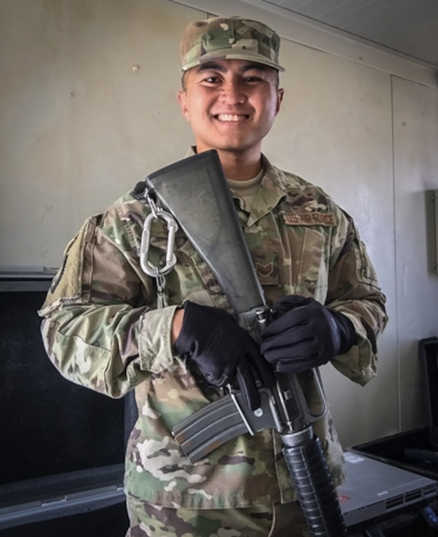 U.S. Air Force Staff Sgt. Junbryan Samson, a cyber network technician assigned to the U.S. Air Forces Central Command communications division at the Combined Air Operations Center smiles for a photo July 24, 2017, at Al Asad Air Base, Iraq. Samson traveled to Iraq to set up 40 network stations in support Air Force units forward deployed in the fight against ISIS. (Courtesy photo by Staff Sgt. Junbryan Samson