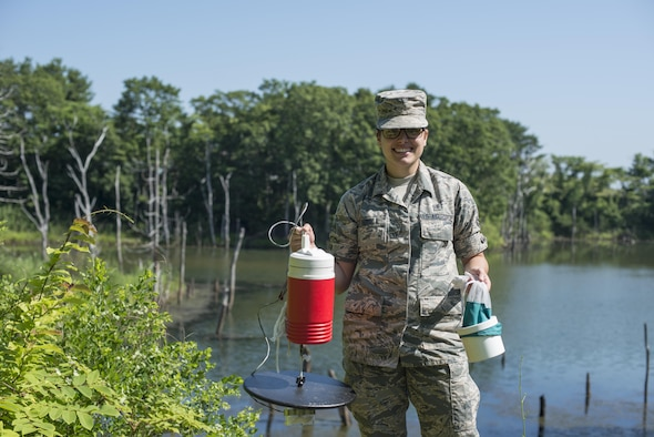 U.S. Air Force Airman 1st Class Morgan Boyd, 35th Aerospace Medicine Squadron public health technician, holds a New Jersey Light Trap- Co2 while posing for a photo at Misawa Air Base, Japan, July 13, 2017. Traps are set up across the base to catch mosquitos, enabling public health to send the females to Kadena Air Base, Japan for disease testing. (U.S. Air Force photo by Senior Airman Brittany A. Chase)
