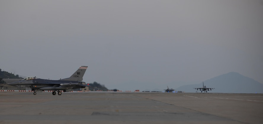 Three F-16 Fighting Falcons, or more commonly known as Vipers, assigned to the 176th Fighter Squadron, 115th Fighter Wing, Wisconsin Air National Guard taxi at Kunsan Air Base, Republic of Korea, Aug. 8, 2017.