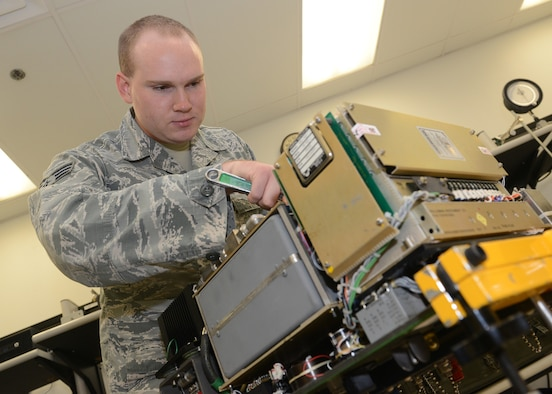 Senior Airman Daniel Bergin, 56th Component Maintenance Squadron precision measurement equipment laboratory technician, works on an air test set at Luke Air Force Base, Ariz., Aug 1, 2017. PMEL supports aircraft, life support, maintenance back shops, and several other agencies on base who utilize equipment requiring strict accuracy. (U.S. Air Force photo/Senior Airman James Hensley)