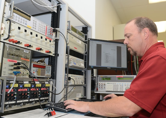 Chris Crossland, 56th Component Maintenance Squadron precision measurement equipment laboratory technician, works on a meter calibrator at Luke Air Force Base, Ariz., Aug 1, 2017. This equipment calibrates multi-meters and panel meters utilized by maintenance back shops throughout the base. (U.S. Air Force photo/Senior Airman James Hensley)