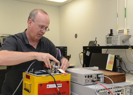 Garth Alexander, 56th Component Maintenance Squadron precision measurement equipment laboratory technician, recalibrates a radar signal simulator at Luke Air Force Base, Ariz., Aug. 1, 2017. The radar tests aircraft threat detection capabilities. (U.S. Air Force photo/Senior Airman James Hensley)