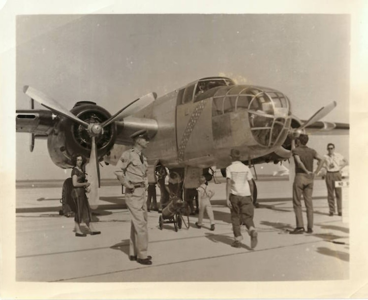 Russel Sharp, prior Air Force crew-chief and flight engineer for the B-25 aircraft, stands near his B-25.